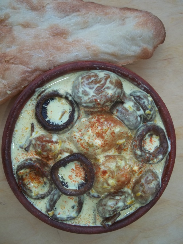 Chicken with mushrooms and mayonnaise ready for serving